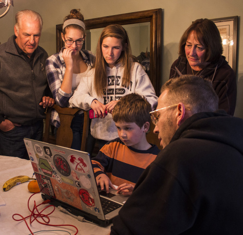 Kowal family learning about the MaKey MaKey