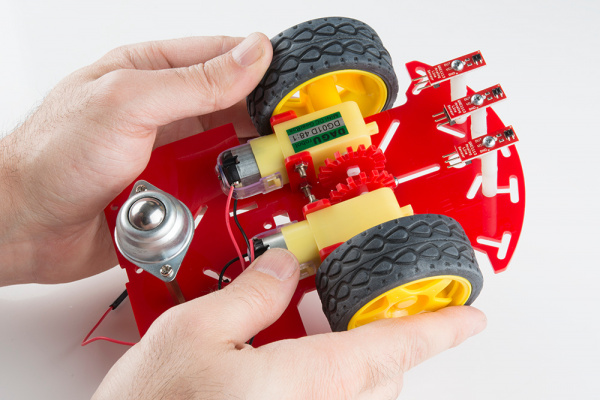 Place the two tires on the motors