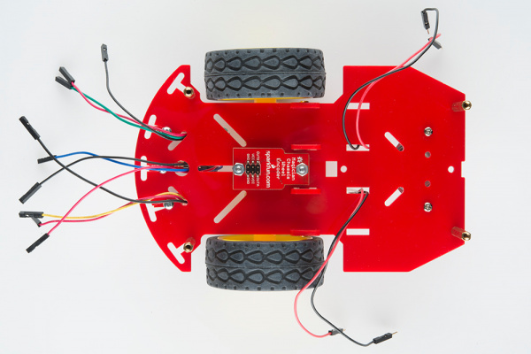 Stick the Line Followers' jumper wires through the chassis