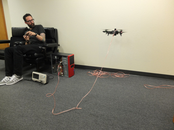 Our first Hacker in Residence testing his tethered quadcopter