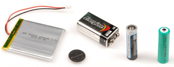 Assorted batteries, each have some way to identify polarity